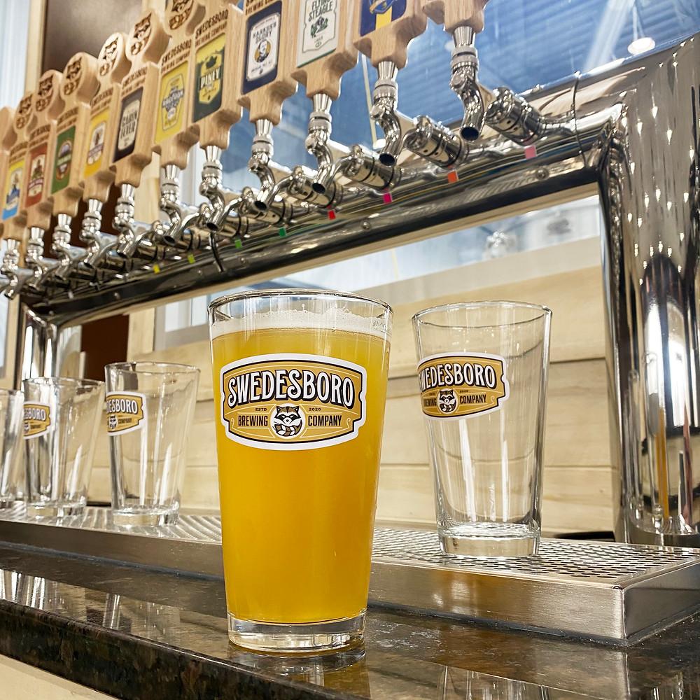 a draft of Swedesboro Brewing Company's flagship Raccoon IPA