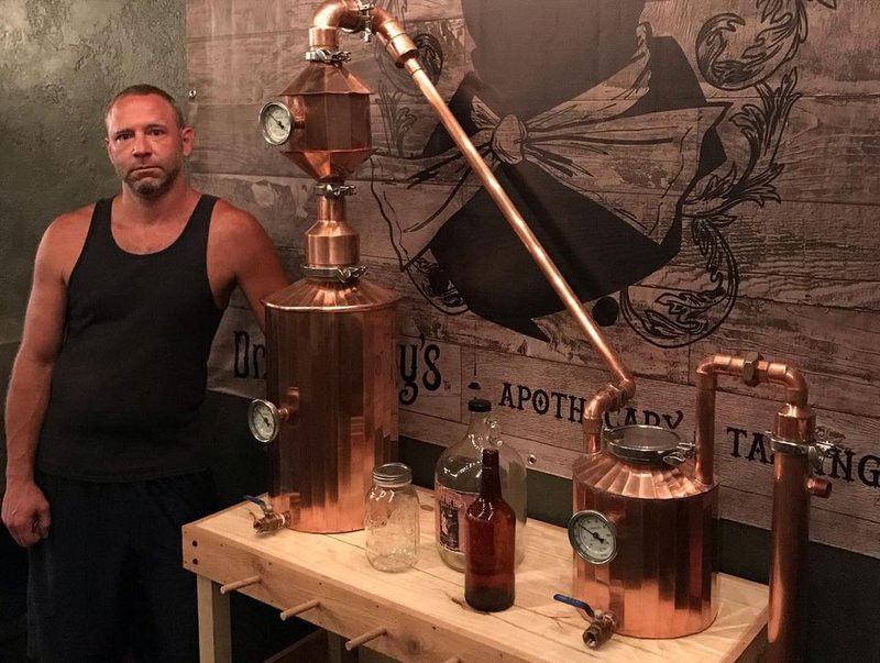 Mike, co-owner of Inspired by Spirits distillery in Pittsburgh, next to one of the stills he designed himself.