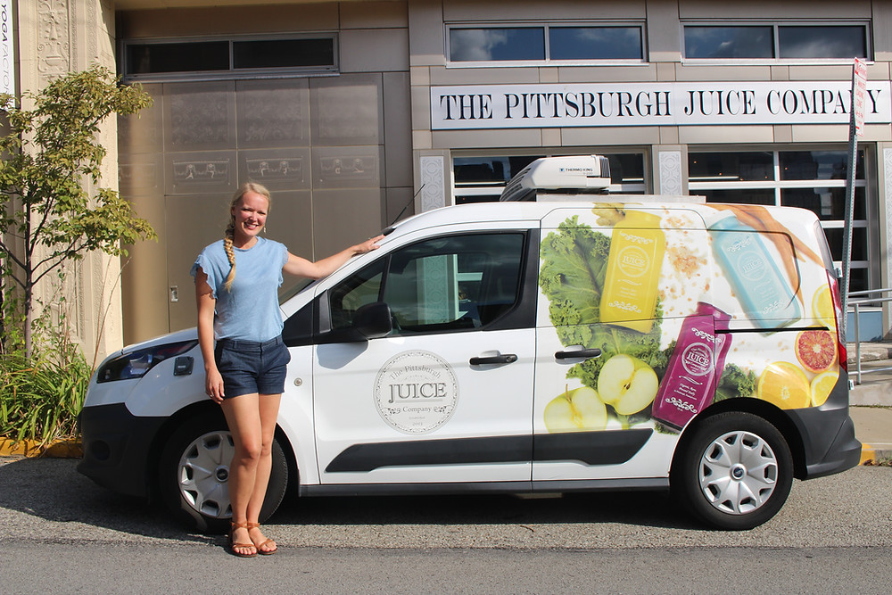 The Pittsburgh Juice Company owner Naomi Homison with the refrigerated truck she crowdfunded