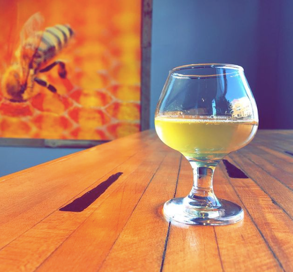 A glass of mead sits on the bar at Slate Point Meadery's taproom