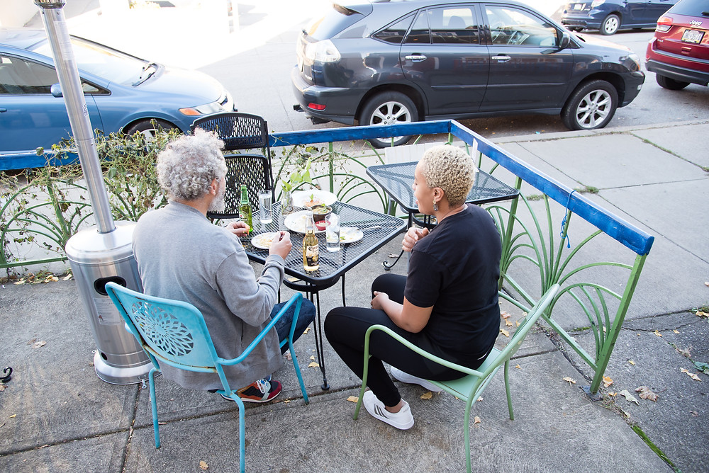 Keyla and Tim, owners of Casa Brasil restaurant in Pittsburgh, enjoy a meal on their patio