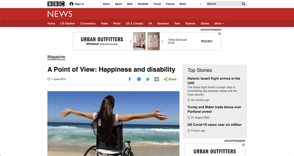 """Screenshot of the article on the BBC News webpage, features the title """"A point of view: happiness and disability"""" and a picture of a girl in a wheelchair with her arms out wide towards the ocean in front of her"""