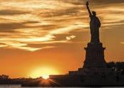 Sun setting on Statue of Liberty