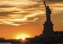 Sun setting on the statue of liberty