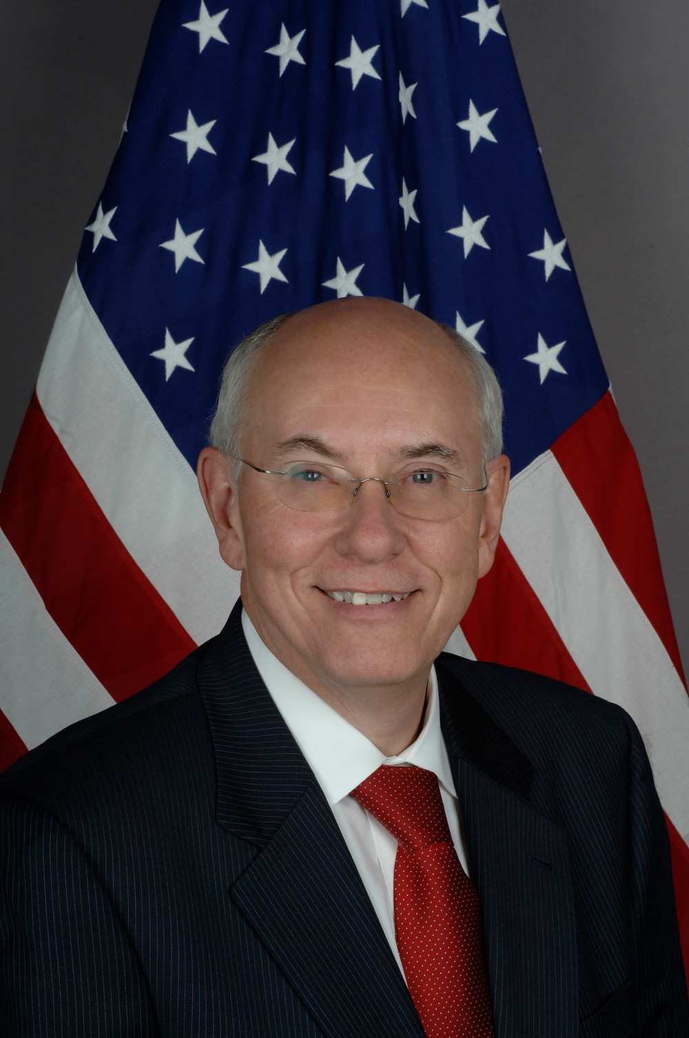 Picture of speaker, Amb. William Garvelink (ret.) in front of United State flag