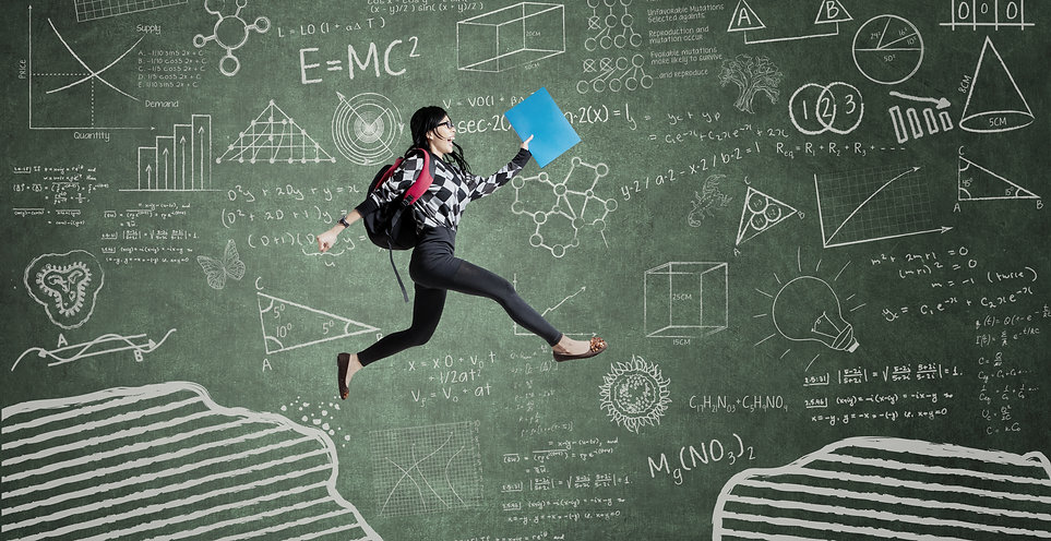 Female student jumping in classroom thro