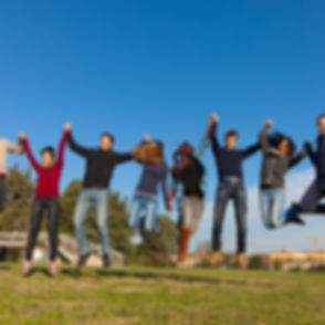 Group of Happy College Students Jumping