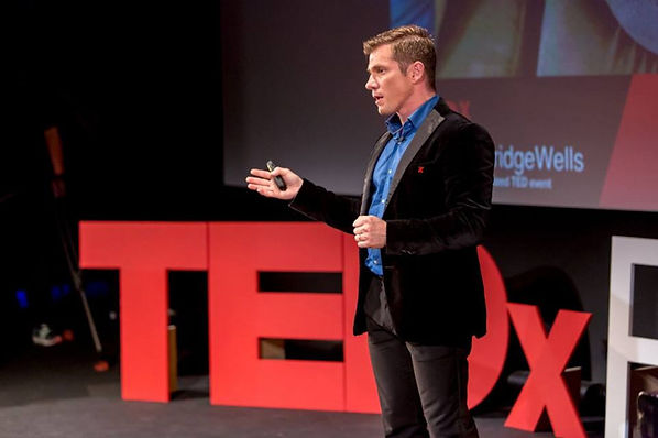 rafael dos santos TED talk image on stage.jpg