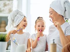family-are-brushing-teeth-AMC9S2V.jpg