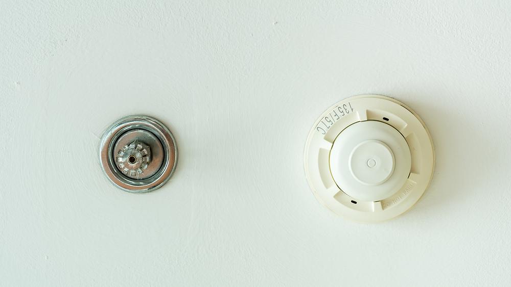 sprinkler system on white ceiling