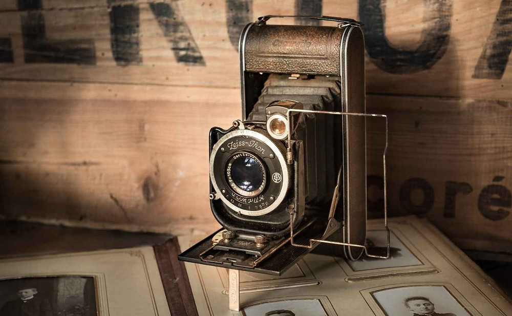 Vintage photo camera that representing past of a modern photo cameras