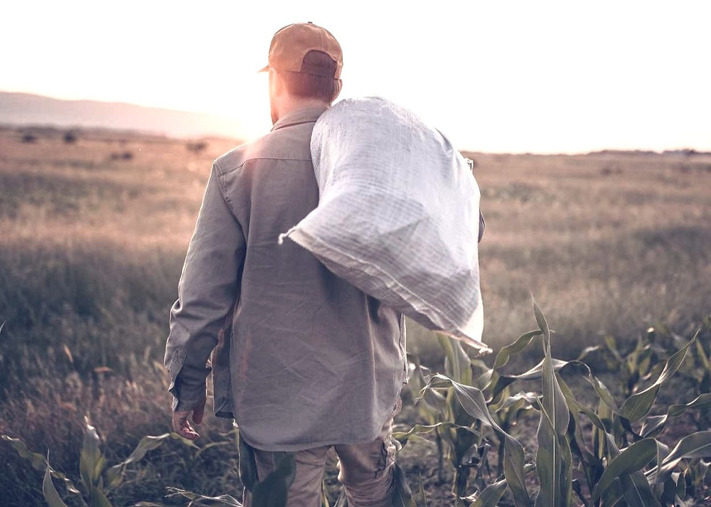 man carrying a sack on his shoulder