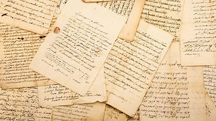 old pages with handwriten reviews on it