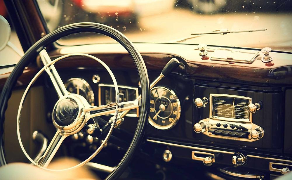 car wheel of vintage car on road trip