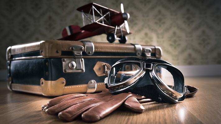 pilot googles, suitcase, travel tips tag