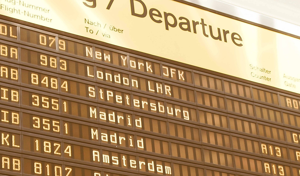 Airport departure board with number of flights, gates and destinations