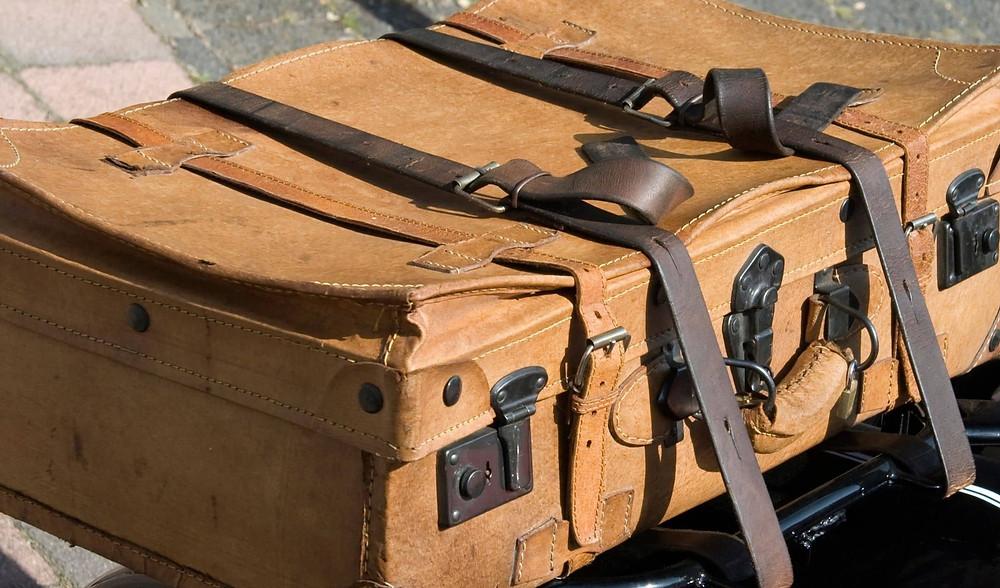 luggage straps on vintage suitcase