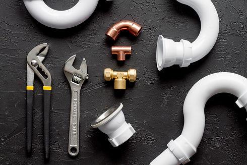 concept plumbing work top view on dark b