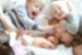 AdobeStock_80360256_Mama kids cuddle.jpg