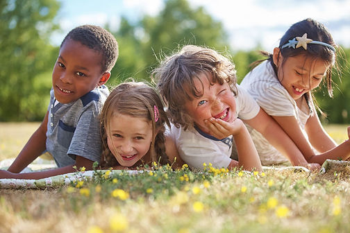 4 diverse kids on grass.jpg