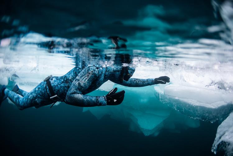 Andrew breathing up beside the iceberg
