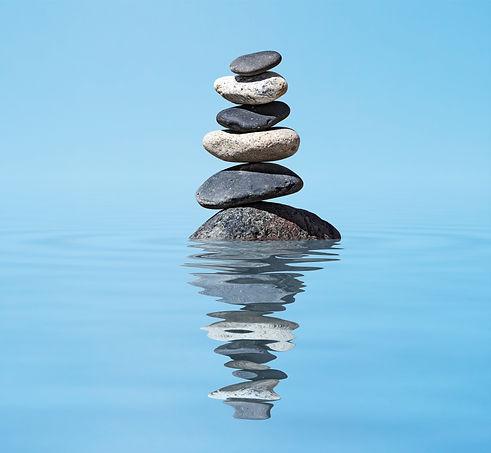 zen-balanced-stones-stack-in-lake-balanc