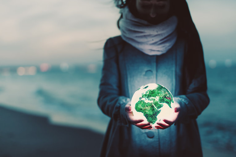 earth-globe-glowing-in-womans-hands-on-t