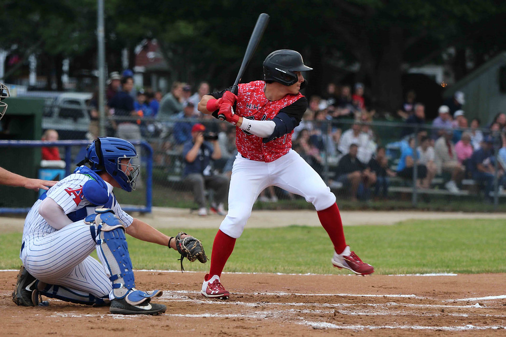 Julio Marcano eyes a pitch while standing at home plate at Veteran's Field in Chatham.