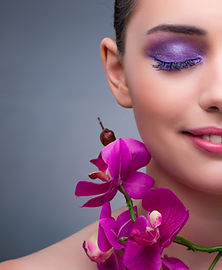 young-woman-in-beauty-concept-with-orchid-flower.jpg
