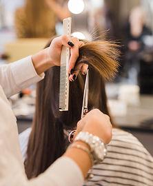 brunette-woman-getting-her-hair-cut.jpg