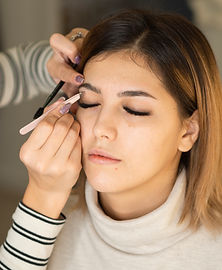 professional-beautican-makes-eyebrows-co