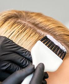 hairdresser-colors-female-customer-hair.