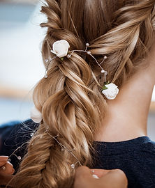 female-hairdresser-making-hairstyle-to-b