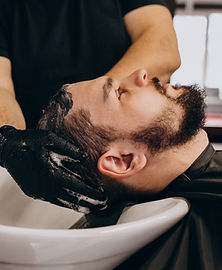 hairdresser-washing-hair-of-a-client-at-