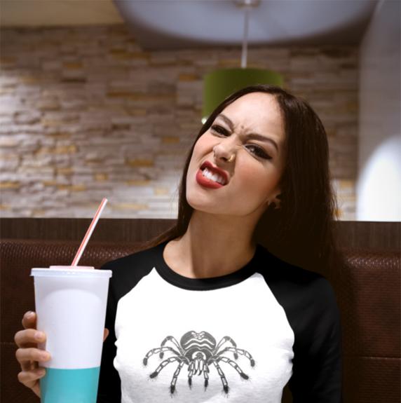 girl-drinking-a-soda-wearing-a-raglan-te