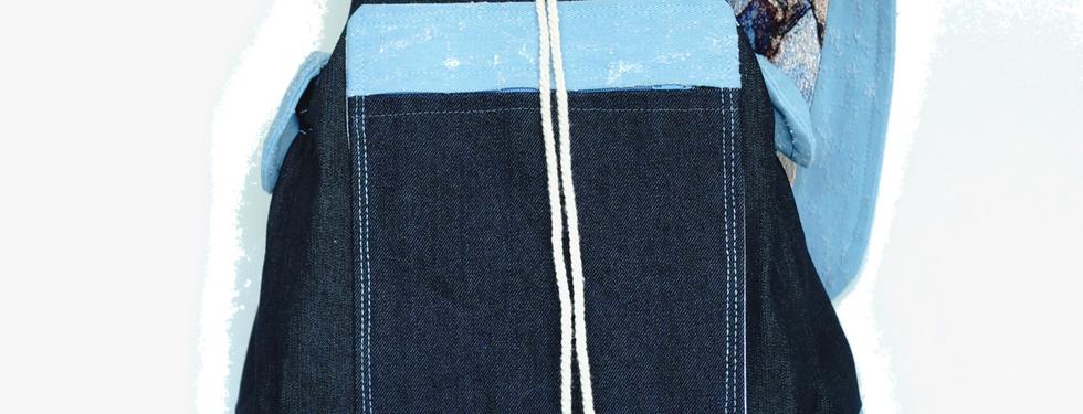 Cordón de algodón y broche magnético.