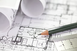 bigstock-Architect-rolls-and-plans-67465