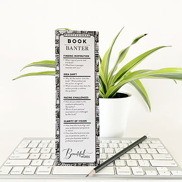 Professional Book Banter bookmark on a keyboard with pencil and plant
