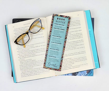 Book Banter bookmark on open book with glasses
