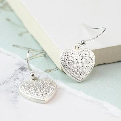 Silver  plated worn finish dotty heart drop earrings