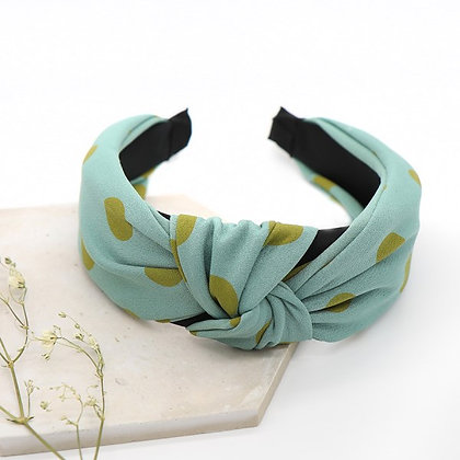 Light blue fabric headband with green polkadots
