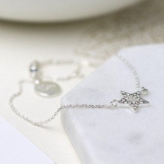 Silver plated fine chain bracelet with crystal inset star 03259