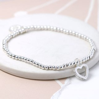 Silver plated bracelet with crystal edged open heart
