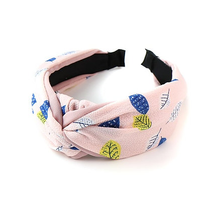 Pink fabric covered headband with leaf print