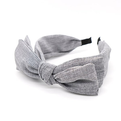 Double bow fabric covered headband in soft grey