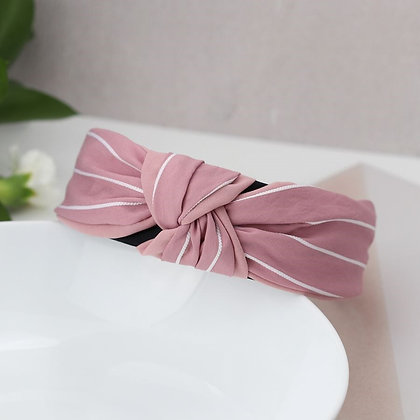 Pink fabric headband with fine white stripes
