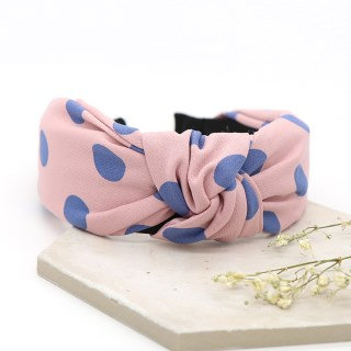 Light pink fabric headband with blue polkadots