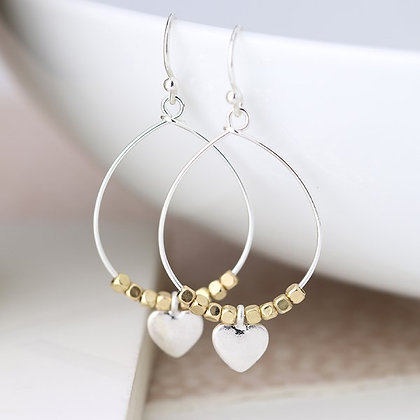 Worn silver teardrop earrings with golden beads and heart 03296