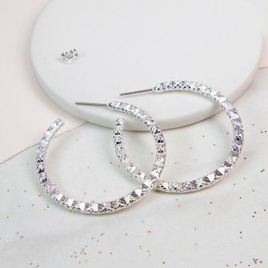 POM Silver plated hoop earrings with striking zig-zag texture