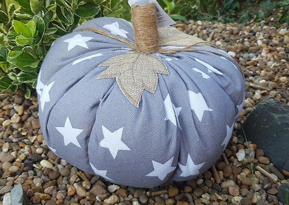 Grey and white star pumpkin door stop